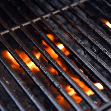 Barbecue grill with flames